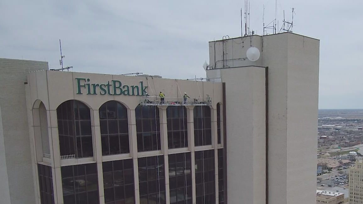 FirstBank Southwest sign placement begins downtown