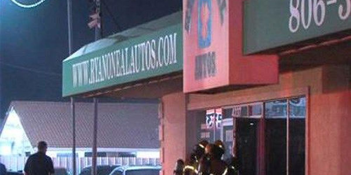 Fire crews extinguish car dealership structure fire