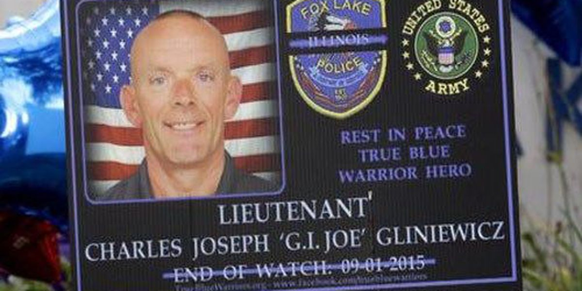 Officer laid to rest while search continues for suspects