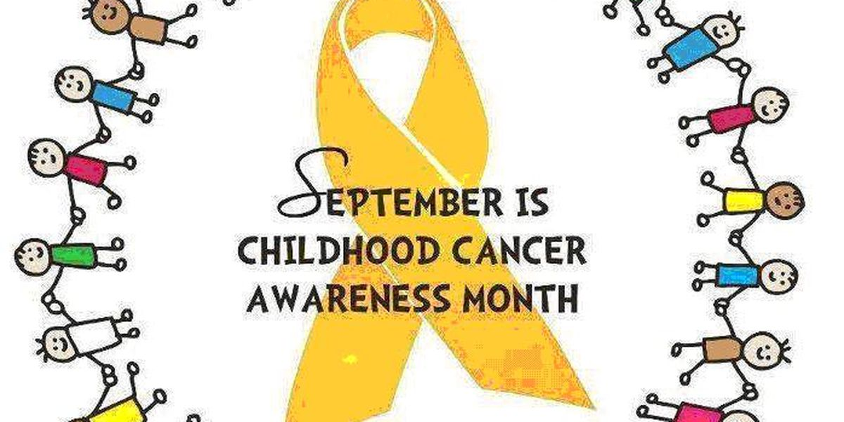 Go Gold: community wide Childhood Cancer awareness ribbon photo & balloon release