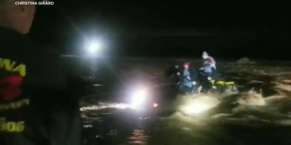 Family rescued after vehicle got stuck in flash flooding