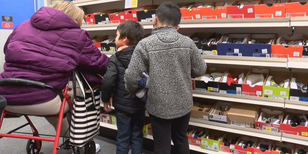 Foster, adopted children shop for new shoes paid for by Amarillo doctor