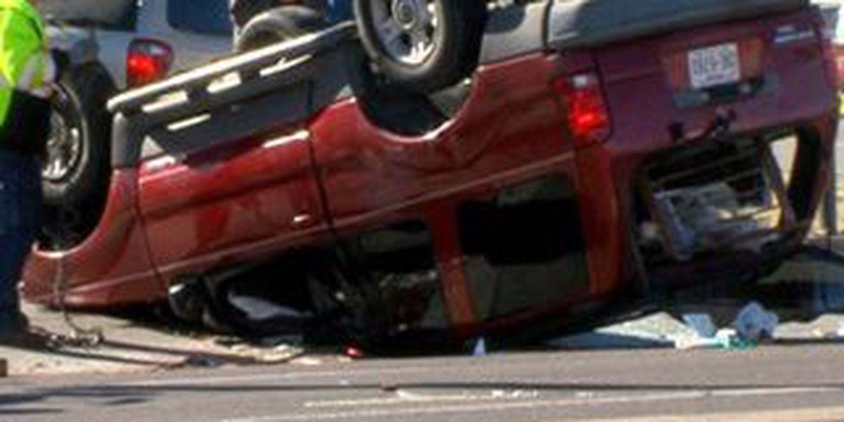 Driver runs red light, rolls vehicle on Amarillo Blvd