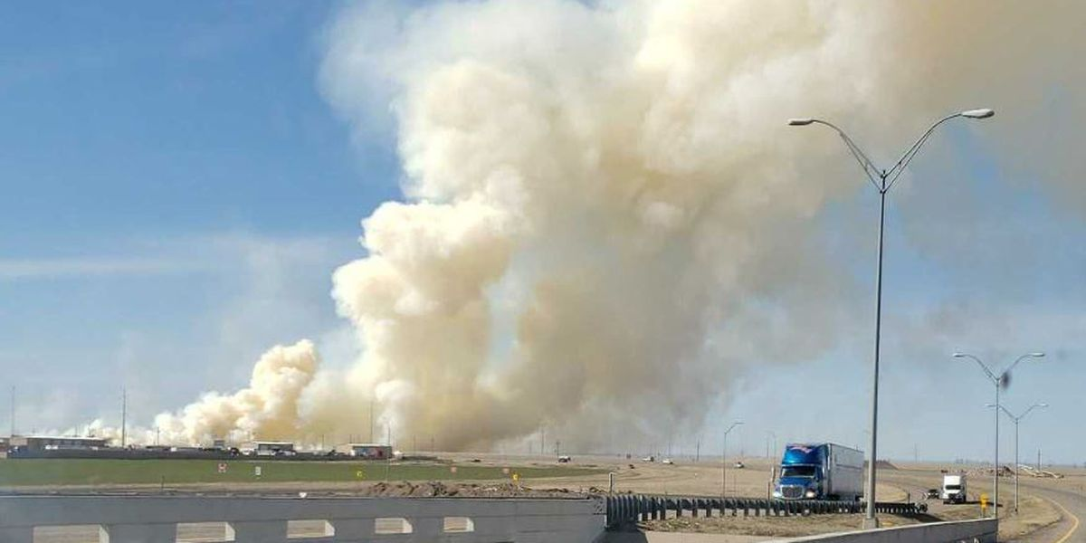 Grass fire near Eastern, North of Loop 335 is 100% contained, all roads open
