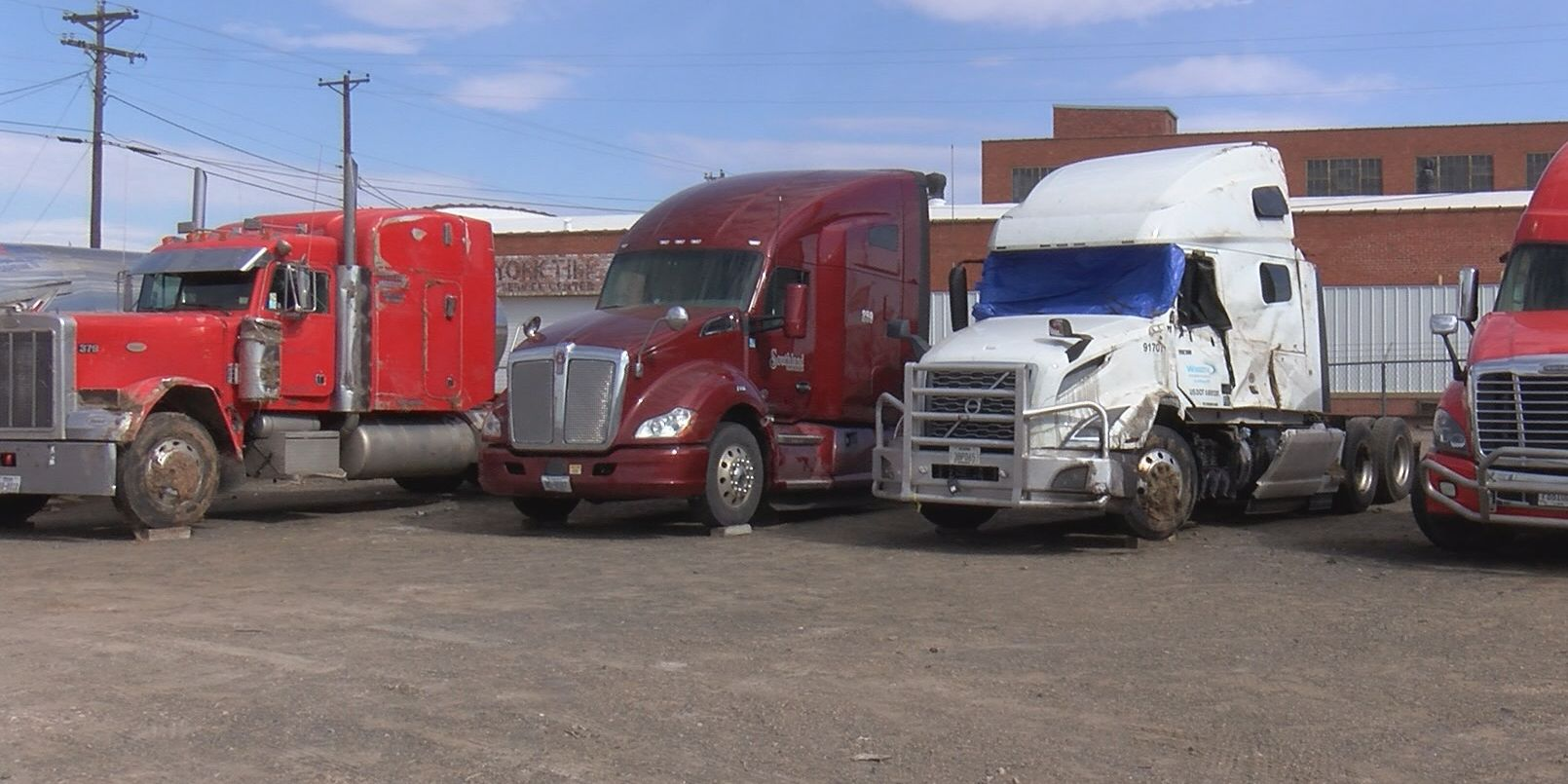 Overturned semi-trucks taken into towing lots and repair shops after wind storm
