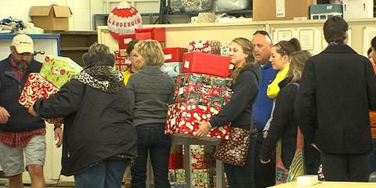 Volunteers deliver thousands of coats, gifts to children in need