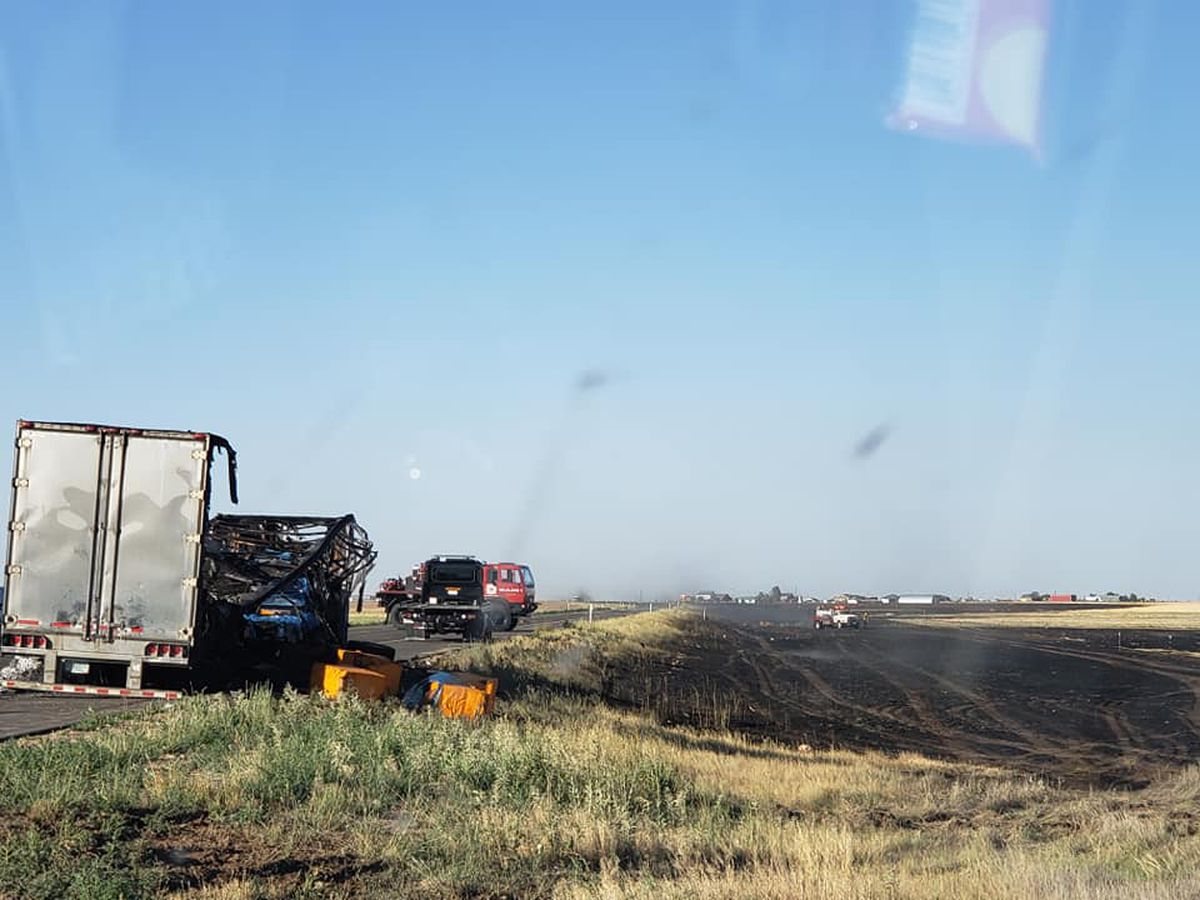 South Loop 335 reopened after semi truck fire turned large grass fire at Farmers Avenue