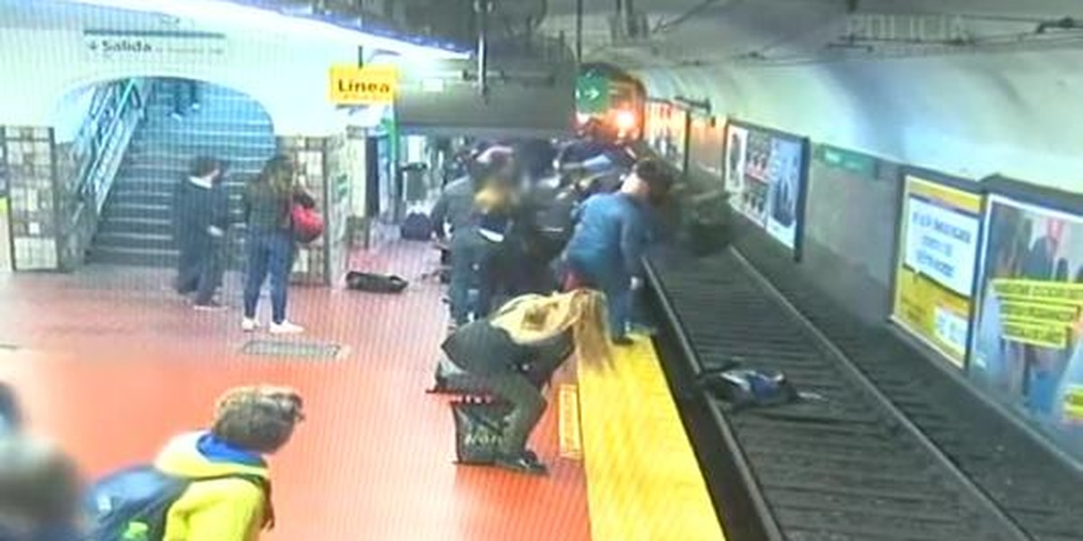 Woman falls onto train tracks and survives
