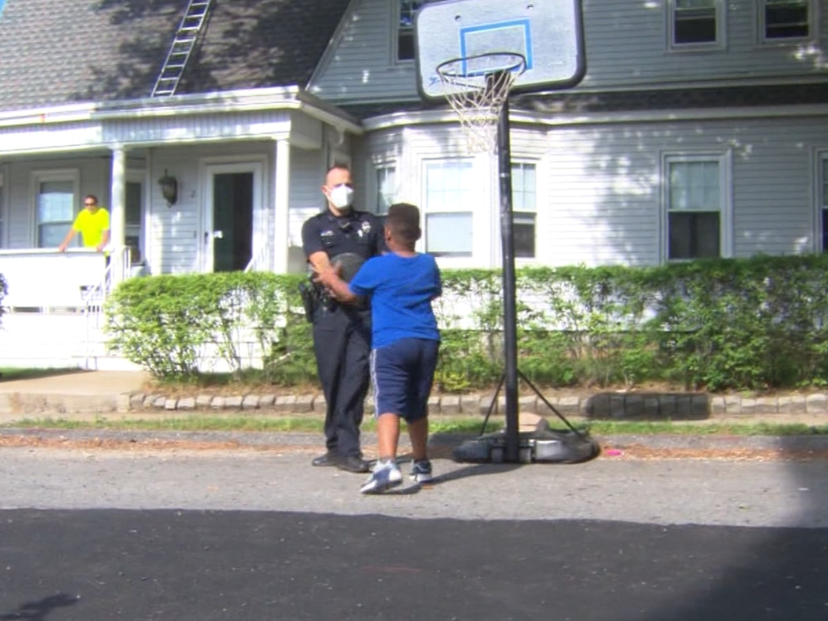 Massachusetts police officer joins boy to play basketball
