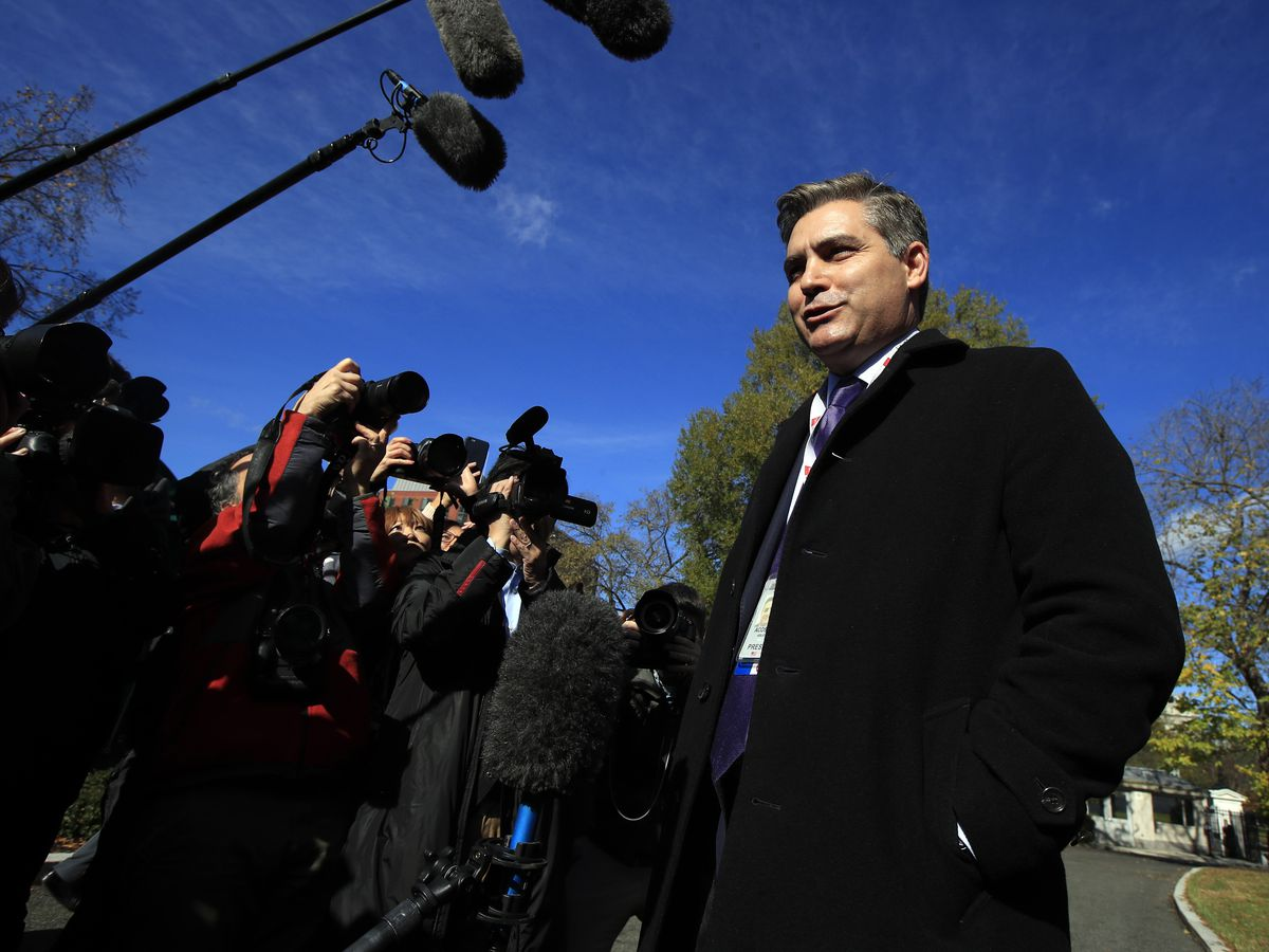 The Latest: White House to fully restore CNN reporter's pass