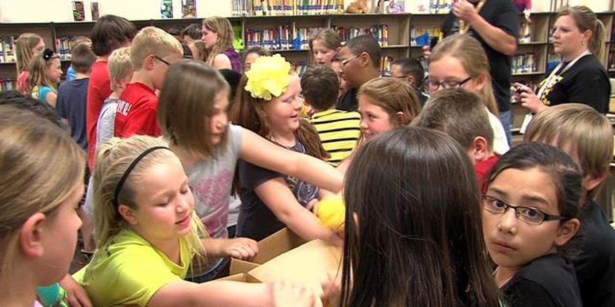 Elementary students pack care boxes for troops