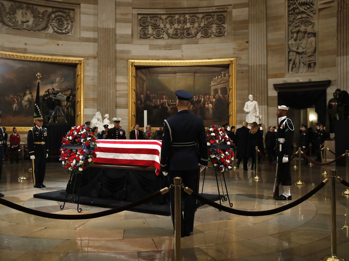 Bush family returns to Capitol rotunda to view casket, thank visitors