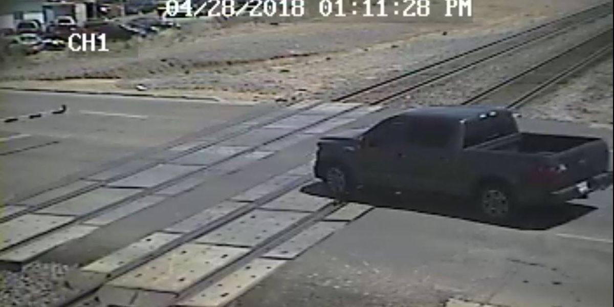 Police alerting residents of dangers in crossing railroad tracks while gates are down