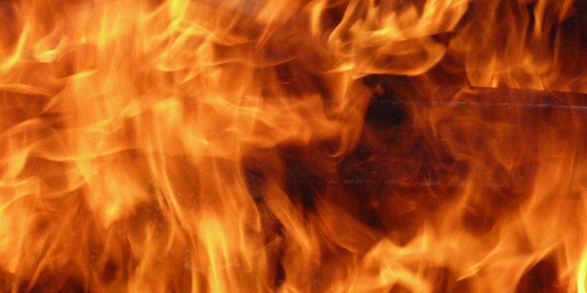 Grass fire causes road closure southwest of Stinnett