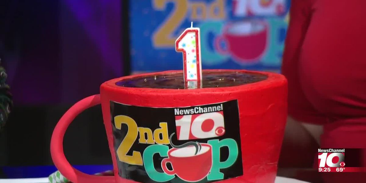 2ND CUP BIRTHDAY: Deana and Richard with Belmar Bakery bring out a birthday cake