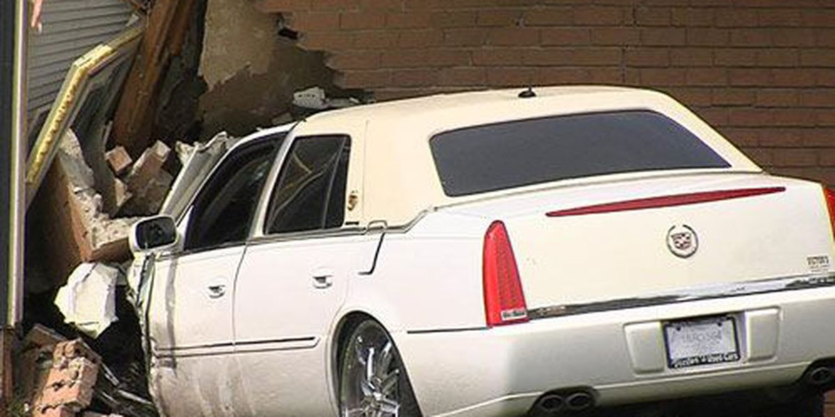 Car hits UPS truck and car, then slams into house