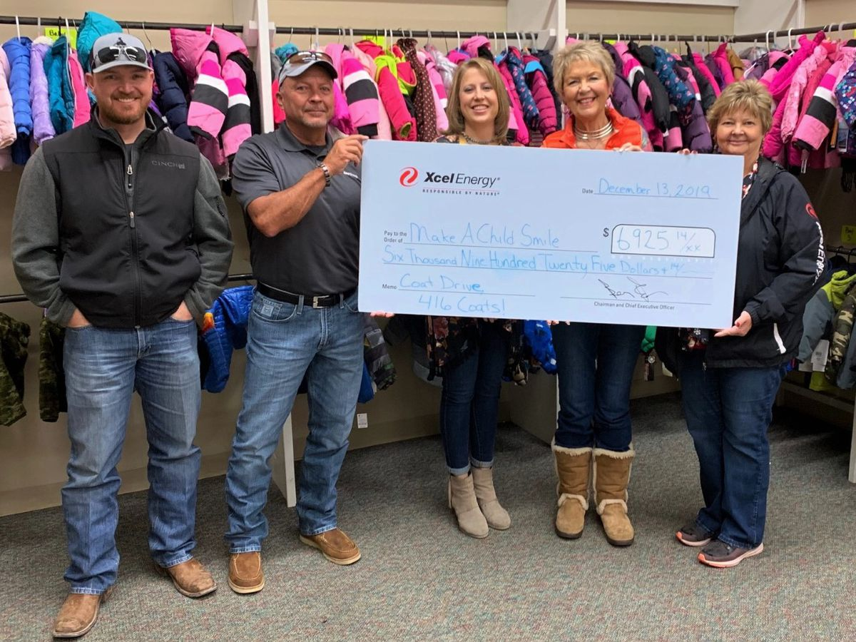 Xcel Energy presents over $6,900 to Eveline Rivers Coat Project