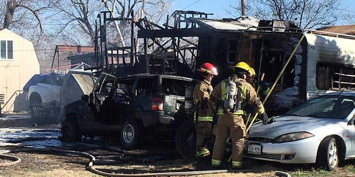 Amarillo house fire spreads to 2 cars, boat, and camper trailer