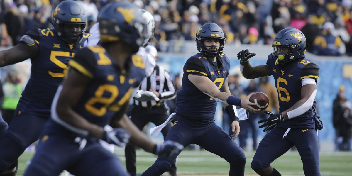 Grier throws for 3 TDs, No. 7 West Virginia beats TCU 47-10