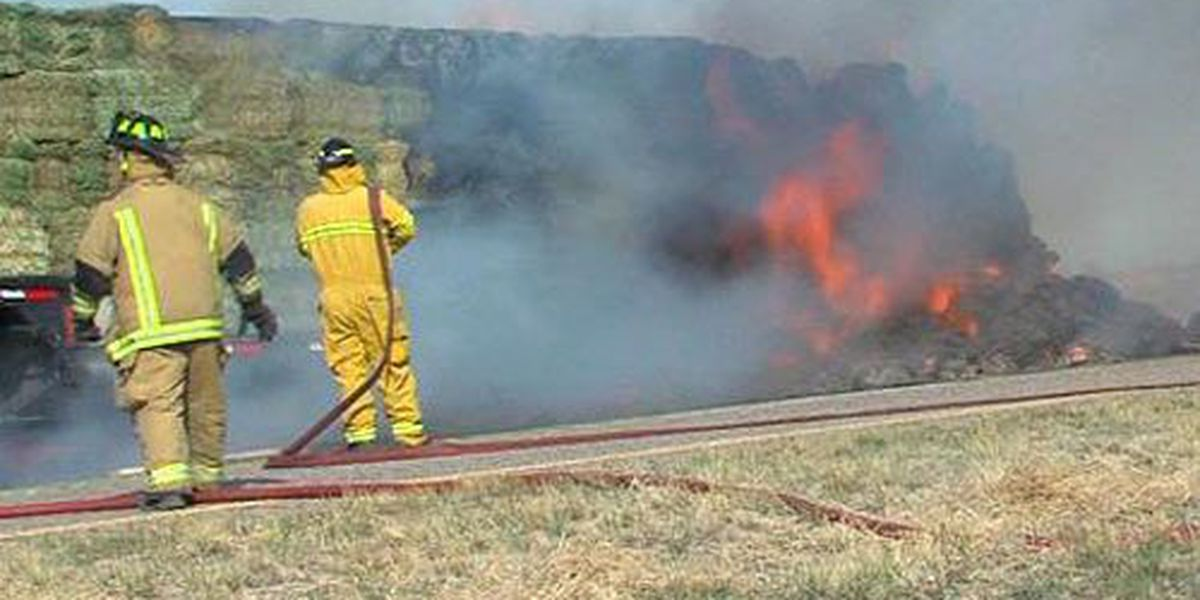 Semi-truck carrying a load of hay catches fire on Highway 287